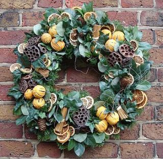 faux christmas wreath with dried fruit by gabriels moon