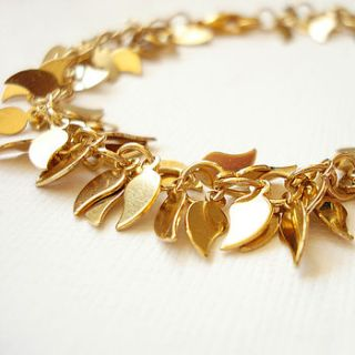 Shimmering gold plated mutli Leaf shaped cluster bracelet.