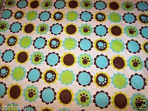 White Flannel wtih Blue Green Brown Dog Paw Prints Inside Circles BTY Adorable