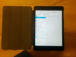 iPad Mini First Generation WiFi Cellular Model A1454 with Two Cases