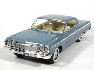 1964 Chevy Impala SS 409 diecast model car 118 scale die cast by Ertl 1 of 2500   Light Blue Toys & Games